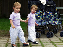 Twins together. Twins hand in hand Royalty Free Stock Images