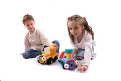 Twins and toys Royalty Free Stock Images
