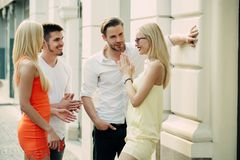 Twins women and men meet on street on summer day royalty free stock images