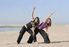 Twins working out. In the beach Royalty Free Stock Image