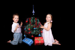 Twins and xmas tree Royalty Free Stock Photo