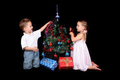 Twins and xmas tree Royalty Free Stock Images