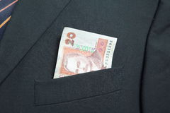 Twintig Oekraïense Hryvnia in de zak van een kostuum Stock Afbeelding