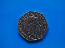 Twintig Pence muntstuk, het Verenigd Koninkrijk in Londen over blauw Stock Afbeelding