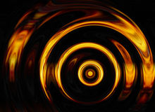 Twirl of bright explosion flash on black backgrounds Stock Photos