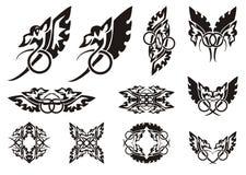 Twirled dragon symbols Stock Photography