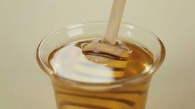 Twirler Dunked In Honey Royalty Free Stock Image