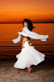 Twirling bellydancer at sunset Royalty Free Stock Image