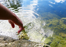 Twirling Finger in River. A person twirling her finger in a river Royalty Free Stock Photography