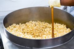 Twirling Popcorns. Twirling popcorn's in the huge pan going crazy and popping stock photo