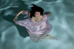 Twirling under water Royalty Free Stock Images
