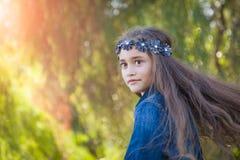 Twirling Young Mixed Race Girl Having Fun Outdoors. Cute Young Mixed Race Girl Having Fun Outdoors stock photos