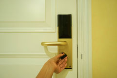 Twist the doorknob for locking the room. Twist the doorknob for locking the hotel room Royalty Free Stock Images