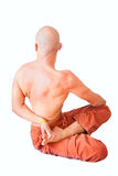 Twist in half lotus position by young man Royalty Free Stock Photos