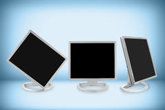 Twist and Tilt. LCD monitor with three different angle, clipping path included royalty free stock photo