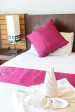Twist towel on bed Royalty Free Stock Images