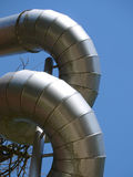 Twisted aluminium construction pipes against blue sky Stock Photos