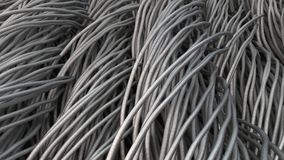 Twisted aluminum wires on black surface. Computer or telephone network. 3D rendering illustration Royalty Free Stock Image
