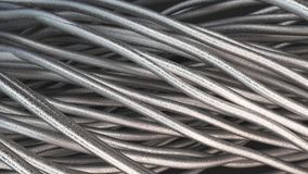 Twisted aluminum wires on black surface. Computer or telephone network. 3D rendering illustration Stock Photo