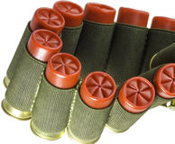 Twisted bandolier with red shotgun cartridges isolated. Closeup shot of twisted bandolier with red shot cartridges isolated Royalty Free Stock Photo