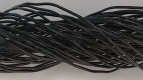 Twisted black cables and wires on white surface. Computer or telephone network. 3D rendering illustration Royalty Free Stock Photo