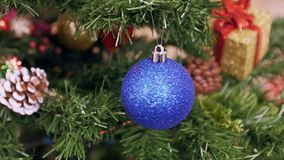 Twisted blue ball on Christmas tree stock video