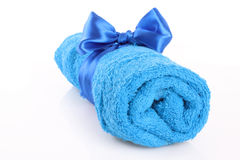 Twisted blue towel with band isolated Royalty Free Stock Photography