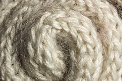 Twisted braided woolen fiber background Stock Image