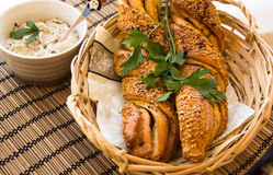 Twisted bread with garlic and sesame seeds with sauce Stock Images