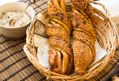 Twisted bread with garlic and sesame seeds with sauce Stock Photography