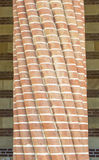Twisted brick plated column Royalty Free Stock Photo