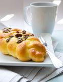 Twisted bun with raisin for breakfast Stock Photo