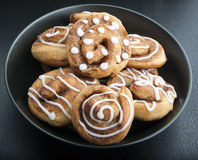 Twisted buns with cinnamon and icing sugar on a black background Royalty Free Stock Images