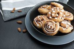 Twisted buns with cinnamon and icing sugar on a black background Stock Images