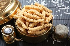 Twisted butter fries, Butter murukku. Murukku is a savoury, crunchy snack from the Tamil, Kerala cuisine of India and Sri Lanka. The snack`s name derives from royalty free stock photography