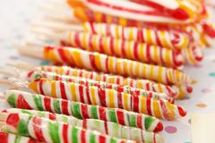 Twisted candy. Stack of colorful, twisted sugar bars Stock Photo