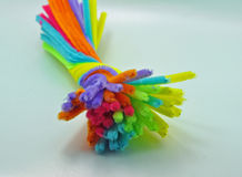 Twisted coloured pipe cleaners Stock Image