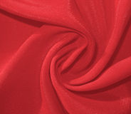Twisted dull red fabric Stock Photography
