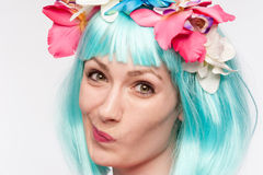Twisted Face Girl Turquoise Wig Flowers Stock Image