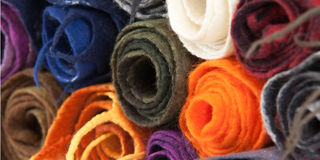 Twisted folded woolen scarves Royalty Free Stock Photo