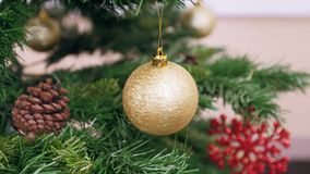 Twisted golden ball on Christmas tree stock footage