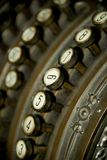 Twisted key on old German cash register Royalty Free Stock Images