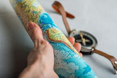 Twisted map in the hand against the background stock photography