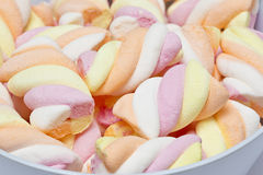Twisted marshmallows of different colours Royalty Free Stock Photography