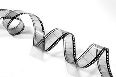 Twisted Movie Film 3 (black and white). A twisted piece of 35mm movie film - on white Stock Photo