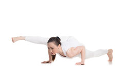 Twisted one legged arm balance yoga pose Royalty Free Stock Photo