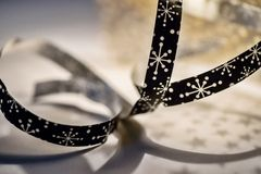 Twisted ornamental ribbon with snowflakes Stock Photo