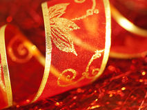 Twisted ornate red gift ribbon Stock Images