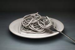 Twisted pair ADSL in Form von Paste wickelte um eine Gabel ein stockfoto