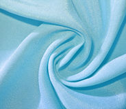 Twisted pale blue fabric royalty free stock photos